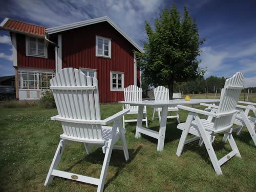 """Schweden Ferienhaus am See in Smaland - Haus """"Torp Staveryd"""" - Garten auf Naturgrundstück"""